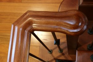 Photo of beautiful natural wood of a finished railing.